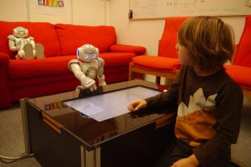 The ALIZ-E project studied how social robots could support children during a stay in hospital: education happened through a large touch screen.